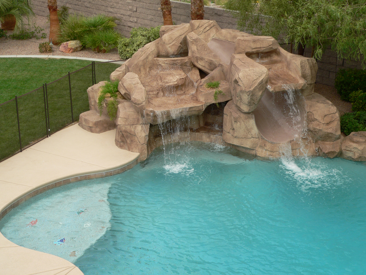 Pool features las vegas pool construction company pool for Swimming pools with slides and waterfalls